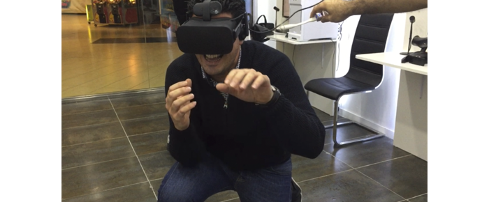 Our colleague Mariano with the Oculus Rift, fighting with the T-Rex